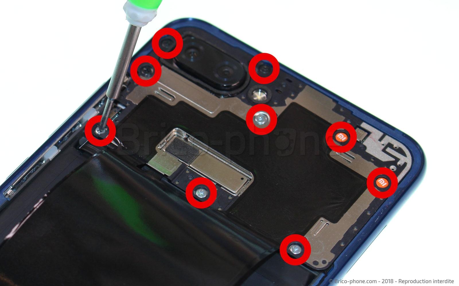 Etappe 6 : Dévisser le cache arrière